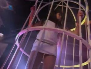 Do real nightclubs actually have girls dancing in cages, or it just a Hollywood thing?